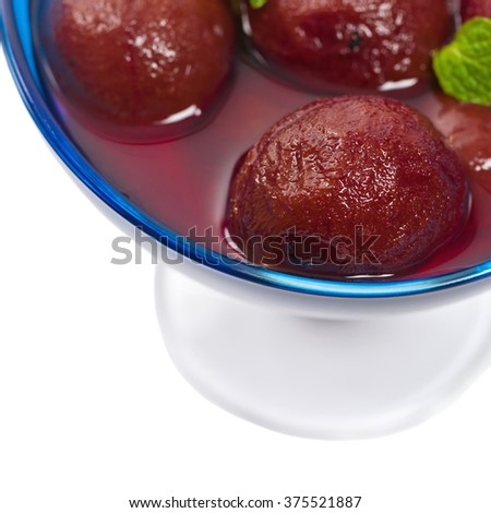 Plum Compote Isolated on a white background. Selective focus.