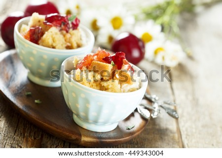 Plum dessert with cream cheese and biscuit - stock photo