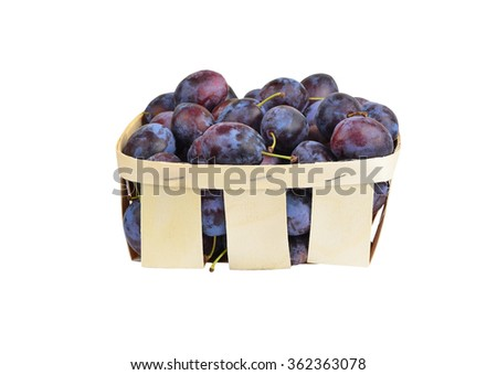 Plum in a wattled basket, isolated on a white background