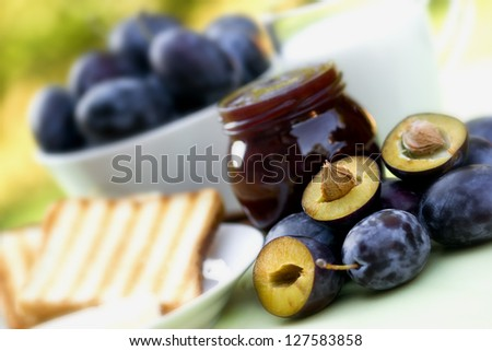 Plum jam, toast and milk - stock photo
