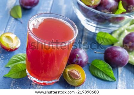 Plum juice - stock photo