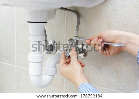 plumber at work - stock photo
