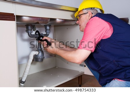 plumber at work with a sink