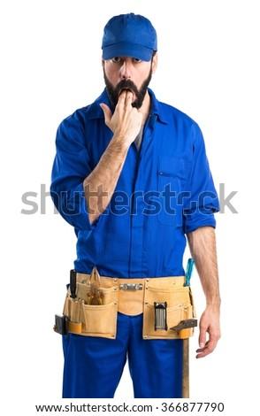 Plumber doing vomiting gesture - stock photo