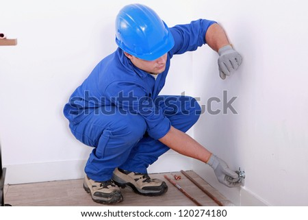 Plumber fitting copper pipes - stock photo
