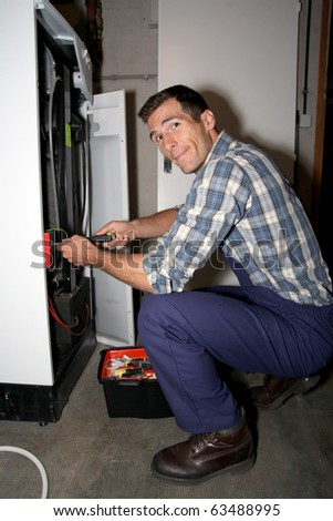 Plumber fixing heater - stock photo