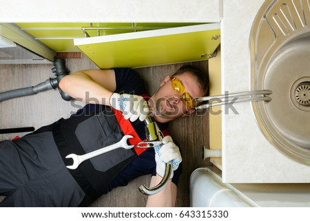 Plumber for kitchen sets sewer
