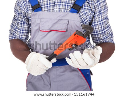 Plumber Holding Red Pipe Wrench Over White Background - stock photo