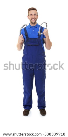 Plumber in blue uniform holding tools on white background