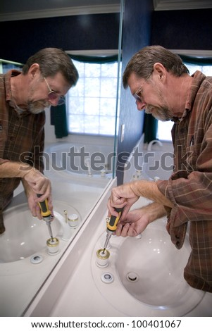 Plumber installing new faucet gaskets to save water and cut down on water bill
