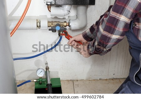 plumber is working on a heating system