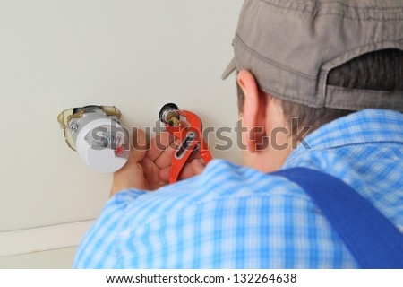 Plumber mointing water supply - stock photo