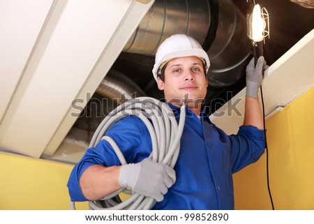 Plumber on a ladder - stock photo