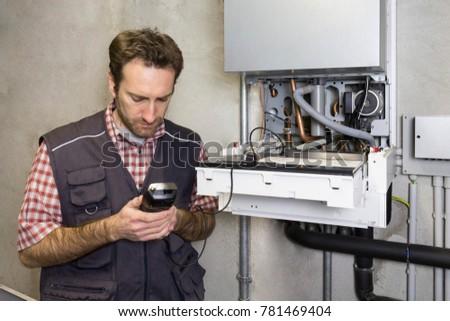 plumber repairing a condensing boiler