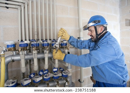 Plumber repairing and performing maintenance - stock photo