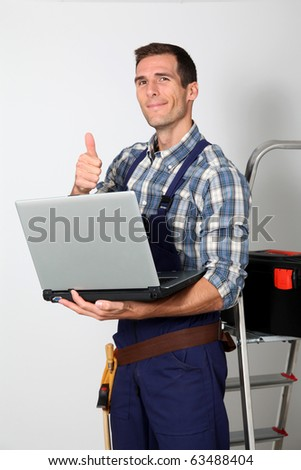 Plumber standing on white background - stock photo