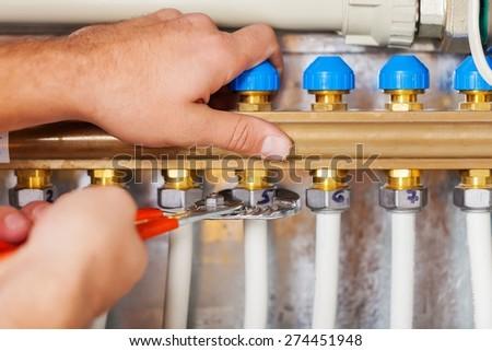 Plumber, Water Pipe, Repairing. - stock photo