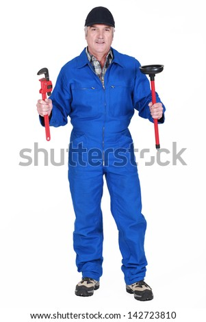 Plumber with wrench and plunger - stock photo