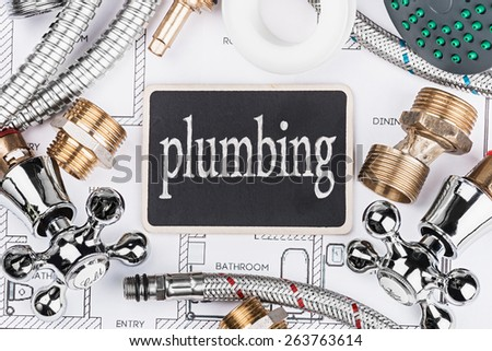plumbing and a blackboard with the text on the drawing - stock photo