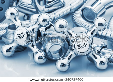 plumbing and tools in a light background. Focus on plumbing taps. toning - stock photo