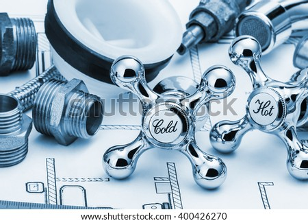 plumbing and tools lying on drawing for repair. Toned image - stock photo