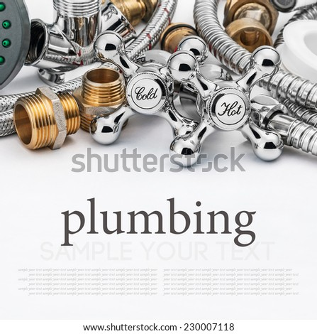 plumbing and tools on a light background. Empty white space above and below for sample background and text - stock photo