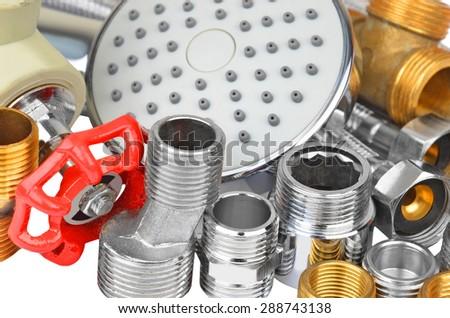 Plumbing fitting, and showerhead - stock photo