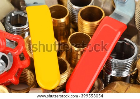 Plumbing fitting and tap from brass and nickel - stock photo