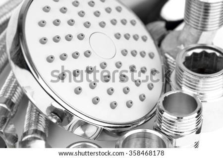 Plumbing fitting, hosepipe and showerhead, close up, DOF - stock photo