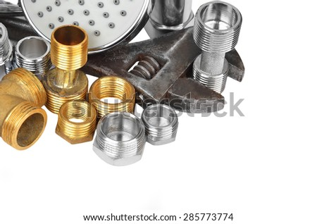 Plumbing fitting, showerhead and wrench, isolated on white background - stock photo