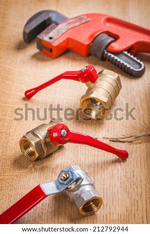 plumbing fixtures and monkey wrench - stock photo