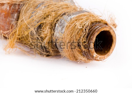 Plumbing pipe with orange rust isolated on white background - stock photo