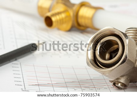 Plumbing supplies - pipes, pencil, documentation and valves - stock photo