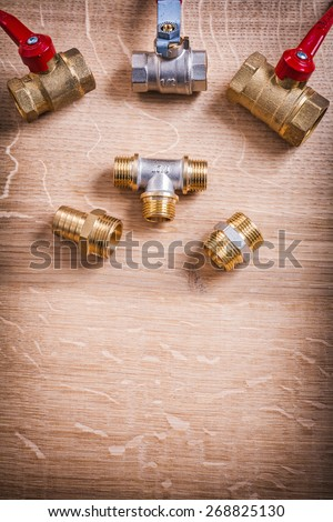 Plumbing Tools Brass Pipe Connectors On Wooden Board  - stock photo