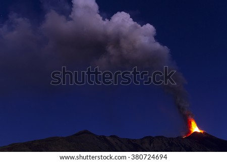 plume of ash and volcanic gases at dawn - stock photo
