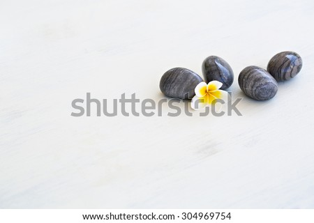 Plumeria flower and stones for spa background - stock photo