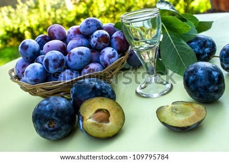 Plums - damson and plum brandy - stock photo
