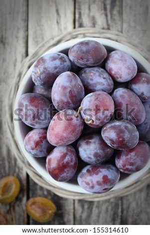 Plums on wooden Background ( vignette )