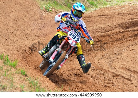 PLUNGE,LITHUANIA-JUNE 12:Unidentified riders in action in Lithuanian Open Motocross Championship 2016 first roundon June 12,2016 in Plunge, Lithuania.