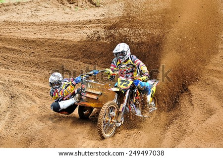 PLUNGE,LITHUANIA-MAY 11:Unidentified riders in action in Lithuanian Open Motocross Championship 2012 first roundon May 11,2012 in Plunge, Lithuania. - stock photo