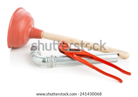 Plunger with wrench and pipe on white background - stock photo