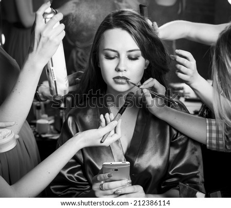 Plus size fashion models prepared for runway by stylish designer. Black and white photography - stock photo