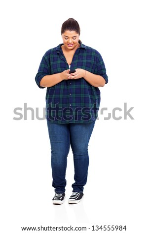 plus size teenager reading email on her smart phone - stock photo