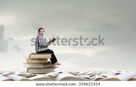 Plus size woman sitting with book in hands
