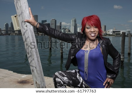 Plus sized model posing by the bay - stock photo