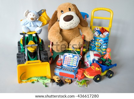 plush and plastic toys isolated on a gray background - stock photo