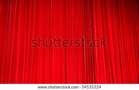 plush red velvet theater curtains. - stock photo