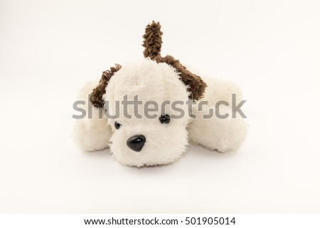 Plush toy dog on white background