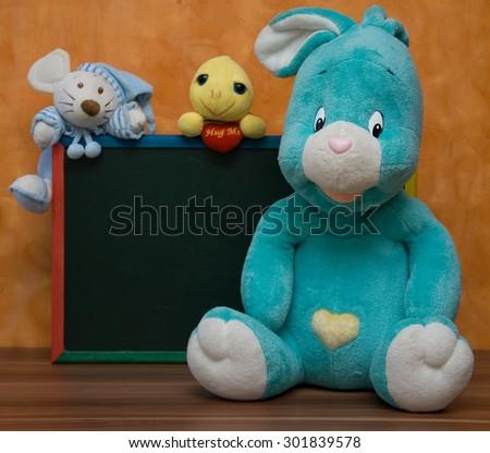 Plush toys with school blackboard - stock photo