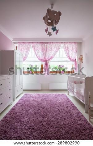 Plush violet carpet in baby girl room - stock photo